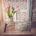 Chai tea glasses with mercury glass vase and carved indian screen